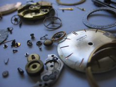 Photo: Broken clock parts blue background