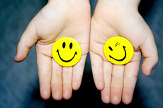 Image Two hands with smiley faces