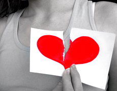 Image Woman holding paper with broken heart